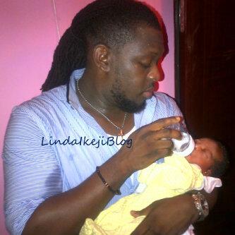 Photo: Timaya and child